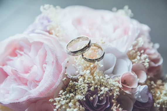 bouquet of flowers with two rings on top