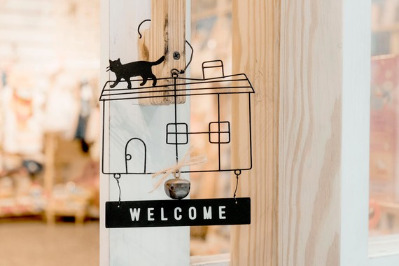 welcome sign hanging on a door
