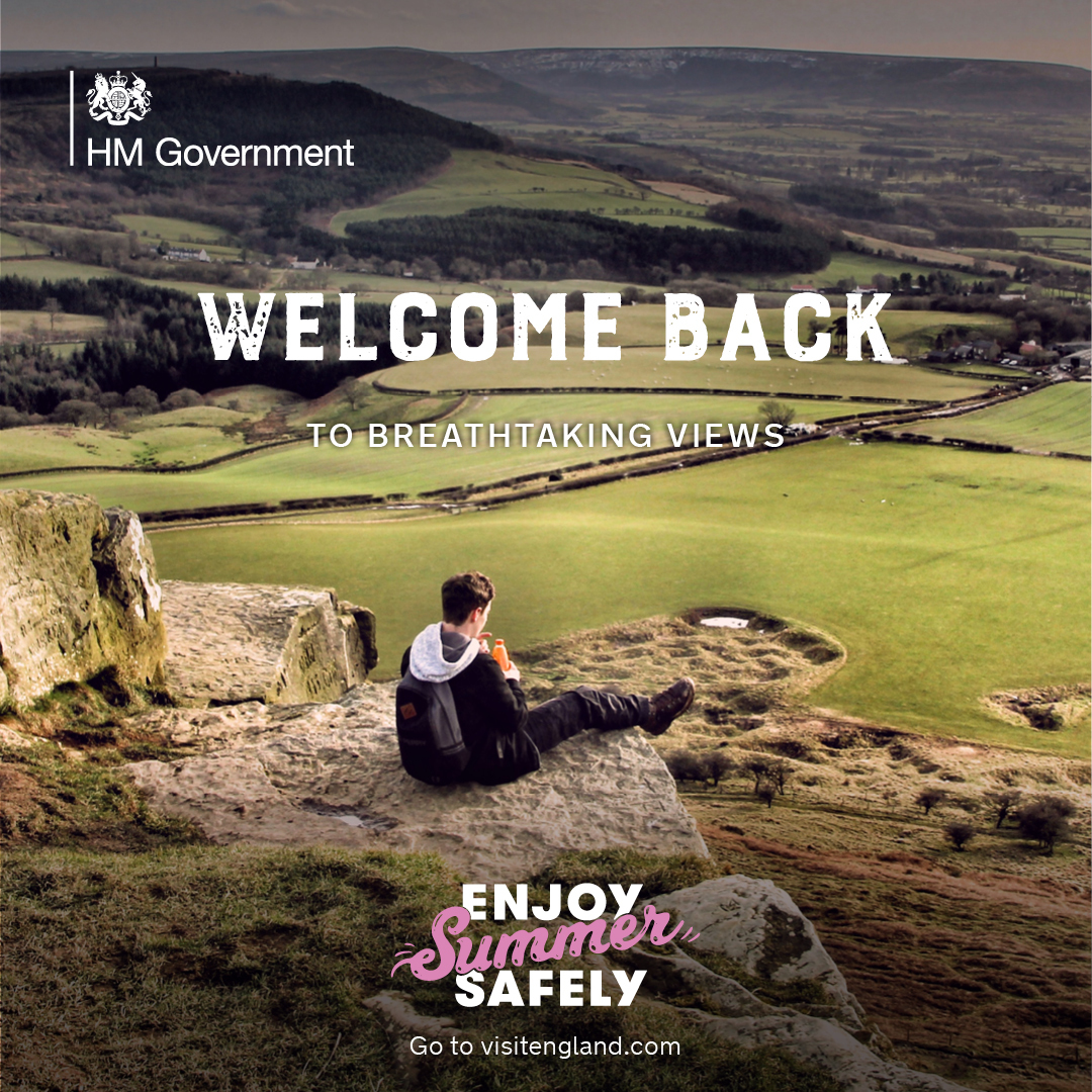 Government welcome back picture with young man sat looking at the countryside