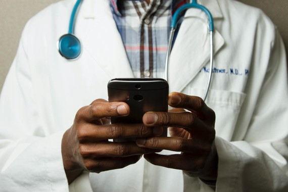 Doctor using a mobile phone