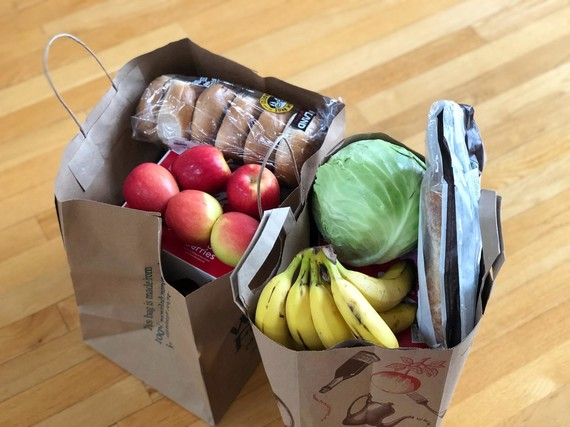Groceries in paper bags depicting shopping