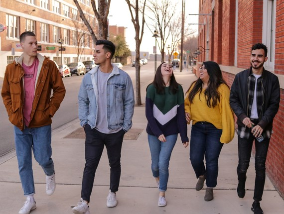 Group of young people walking along a street