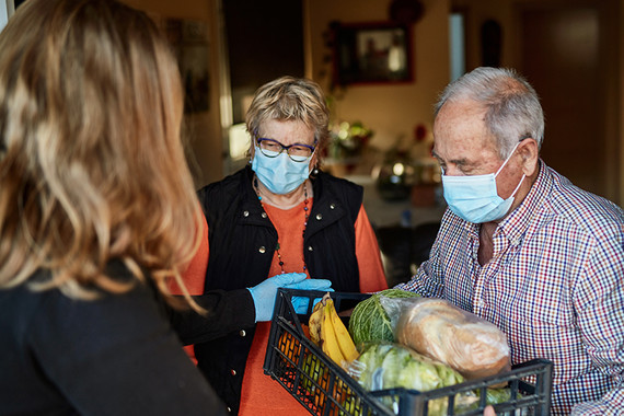 Elderly couple having shopping delivered
