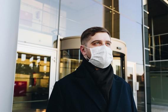 Man wearing mask on street