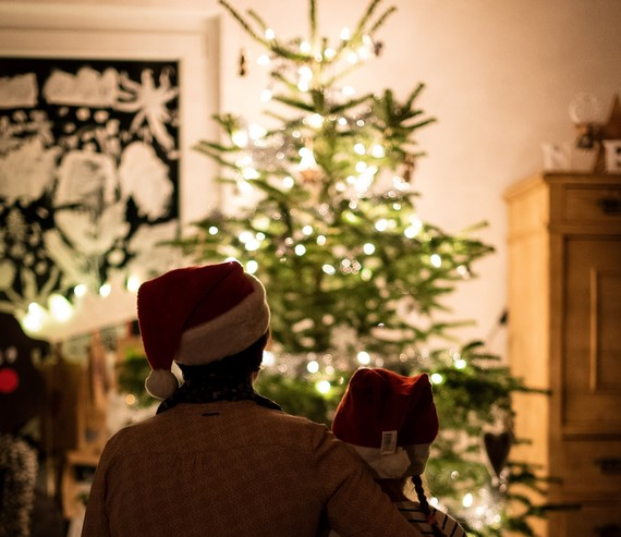 Parent and child looking at Christmas tree