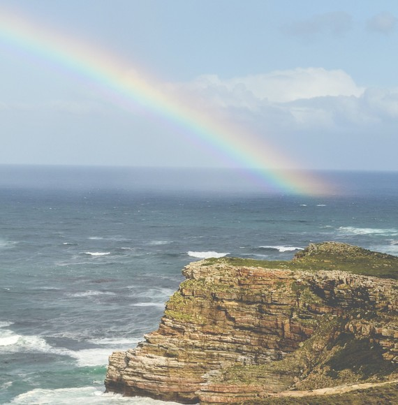 rainbow over rough seas
