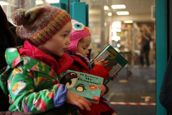 children collecting books from library