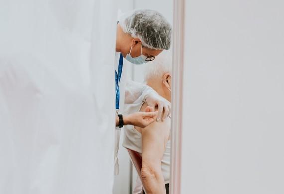 elderly man getting vacination
