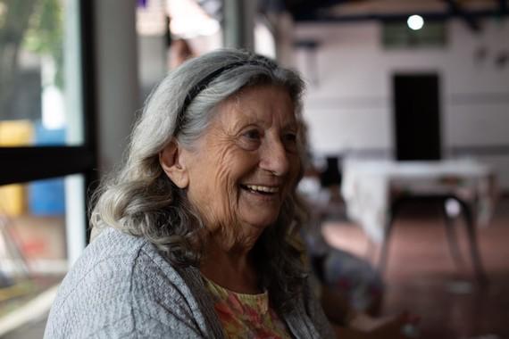 elderly lady in village hall