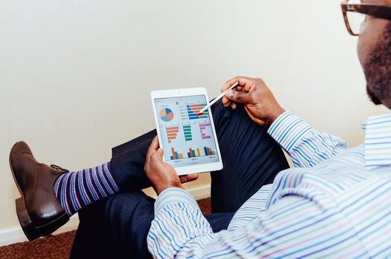 Man looking at marketing analytics. Photo by Adeolu Eletu on Unsplash