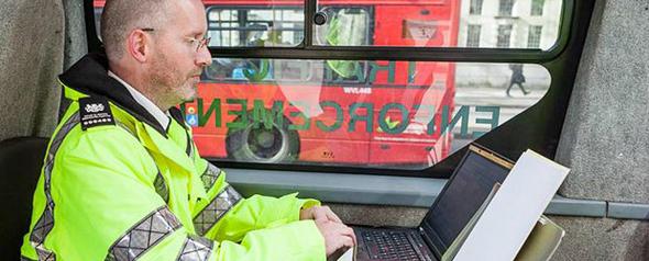 A DVSA traffic examiner examining records