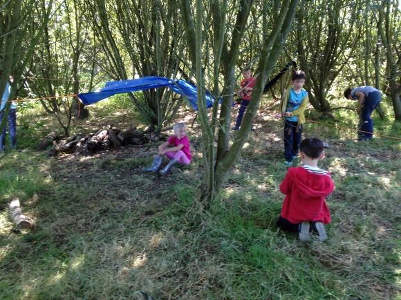 Wild East Devon event with children having fun in the woods