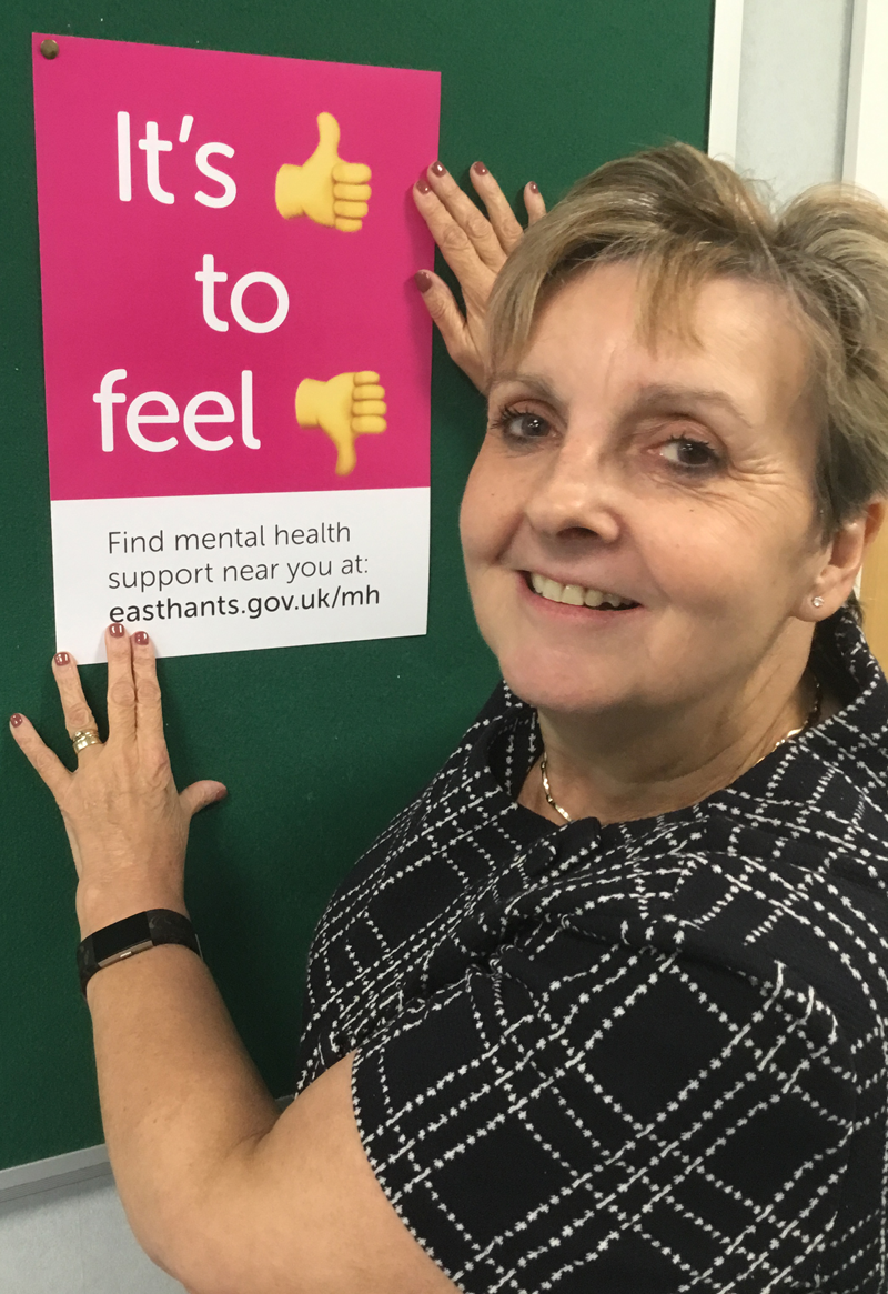 Cllr Butler with one of the mental health support posters