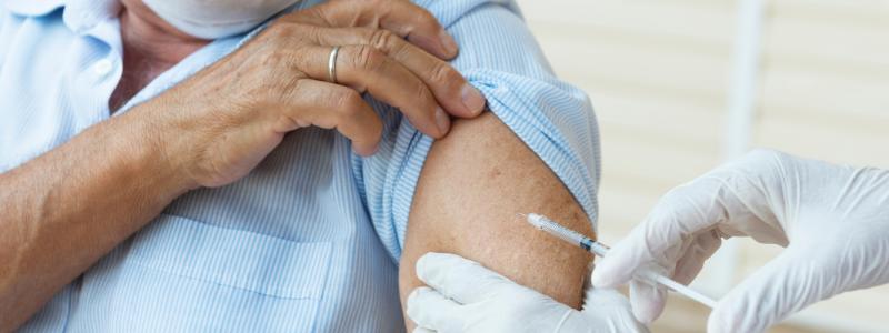 Person administering a vaccine