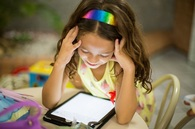 Child reading tablet
