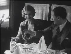 A still from a black and white film about trains