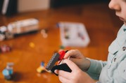 Child playing with lego blocks