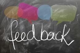 the word 'feedback' is written on a chalk board