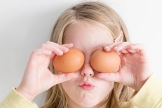 Girl holding eggs.