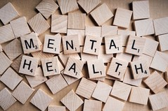 the words 'mental health' are spelt out on wooden scrabble tiles