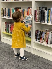 Child looking at a book