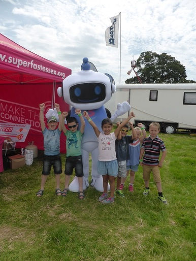 Super Sam with children at the Tendring Hundred Show