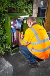 Gigaclear engineer working at broadband cabinet
