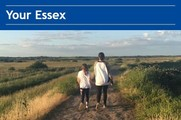 mother and daughter walking in Essex countryside