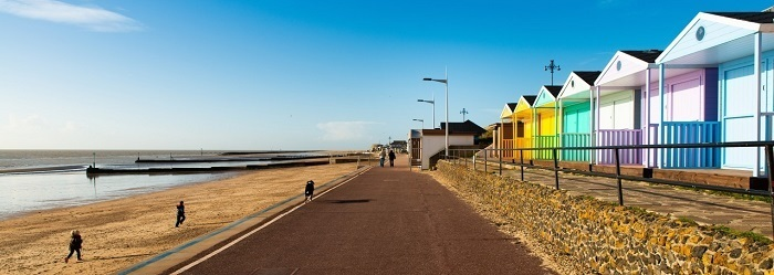 brightly coloured beach huts overlooking the beach