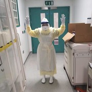 Liz the nurse standing in a hospital in full PPE