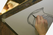 someone drawing a pot using a pencil