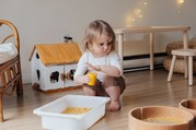 girl playing with pasta