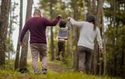 parents lifting child up
