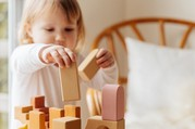 child with wooden blocks