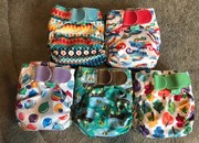 Five patterned cloth nappies