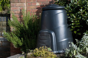 A large  compost bin in a garden