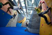 A group of friends climbing at The Lock Climbing Wall
