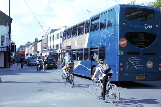 Buses, cyclists, and cars travelling into Cambridge city centre