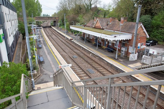 View of Whittlesford Parkway station platform and train line taken from the bridge over the tracks