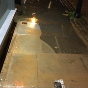 Picture of jet washer being used on a dirty pavement