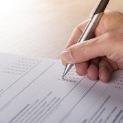 Picture of man completing a survey