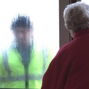 Picture of a woman answering the door