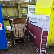 Picture of dumped old chair and large cardboard box