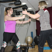 Two women exercising in a gym