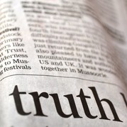 Picture of a newspaper with the word 'truth' highlighted