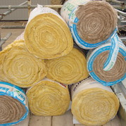 Picture of stacked rolls of roof insulation