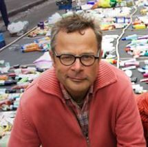 photo of hugh fearlney whittingstall surrounded by waste from recent TV series