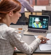 female worker watches a live webinar