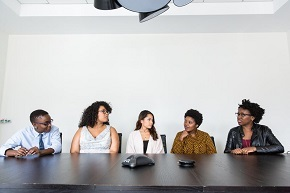 diverse group of people sitting down