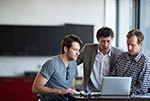 men at computer